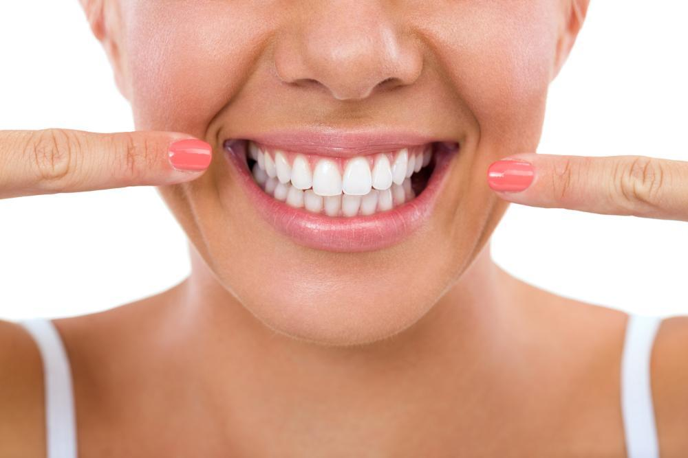 woman with gleaming, bright smile I KOR teeth whitening in fayetteville ar