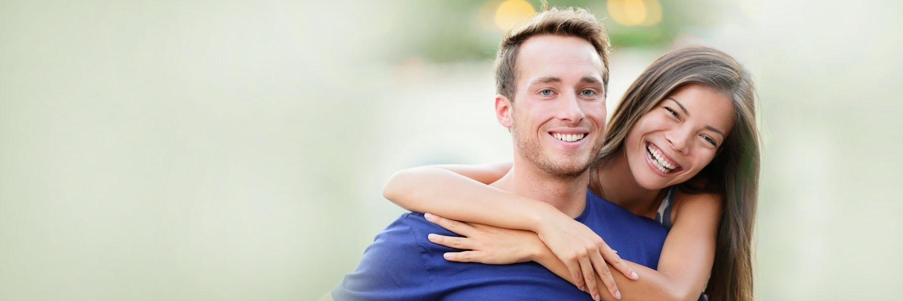 Young couple smiling & hugging l Northwest Arkansas Family Dental