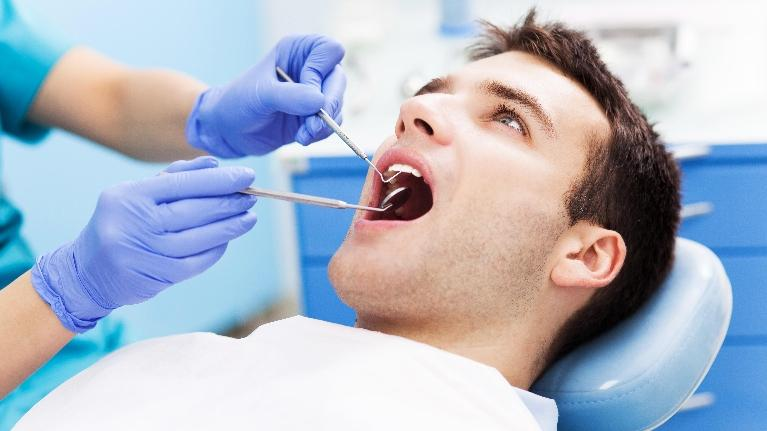 Man in Dentist Chair | Northwest Arkansas Family Dental